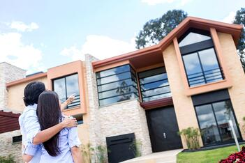 Couple looking at a beautiful house to buy.jpeg