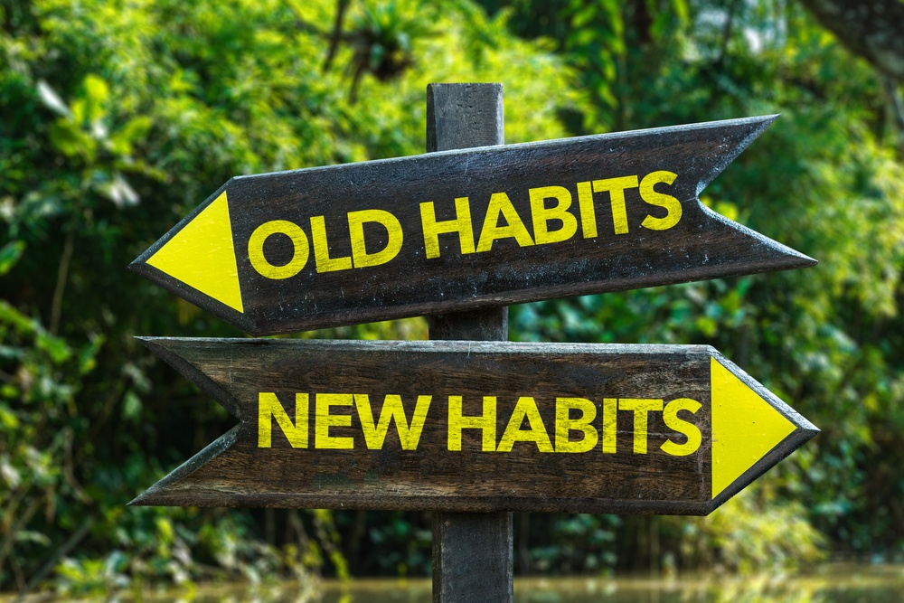 Old Habits - New Habits signpost with forest background.jpeg